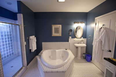 Every room has a whirlpool tub for two and separate shower.