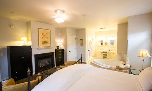 Garden King Bedroom Suite (Heritage Estate), with gas fireplace, whirlpool tub for two, private bath, and private enclosed patio deck.