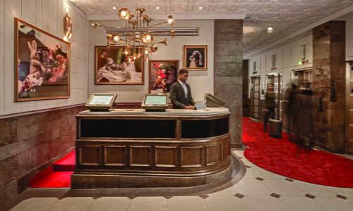 1920s oak Cigar Bar that serves as the hotel's front desk
