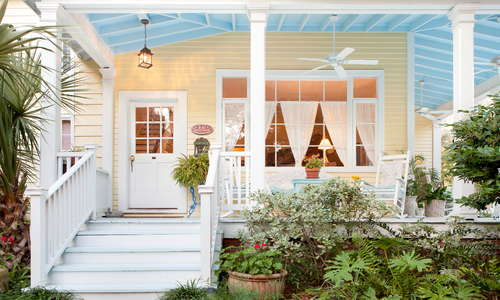 The haint blue porch ceiling color adds to the storied beach cottage's southern appeal. The popular bed and breakfast inn is now getting fresh restoration, due for completion in March 2018.