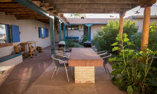 Shared courtyard and patio, complete with grills, fire pit and koi pond