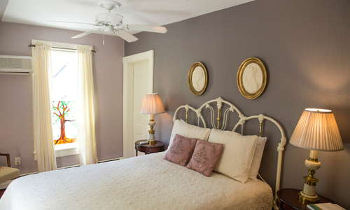 Our Cameo Room with a queen bed and full bath.