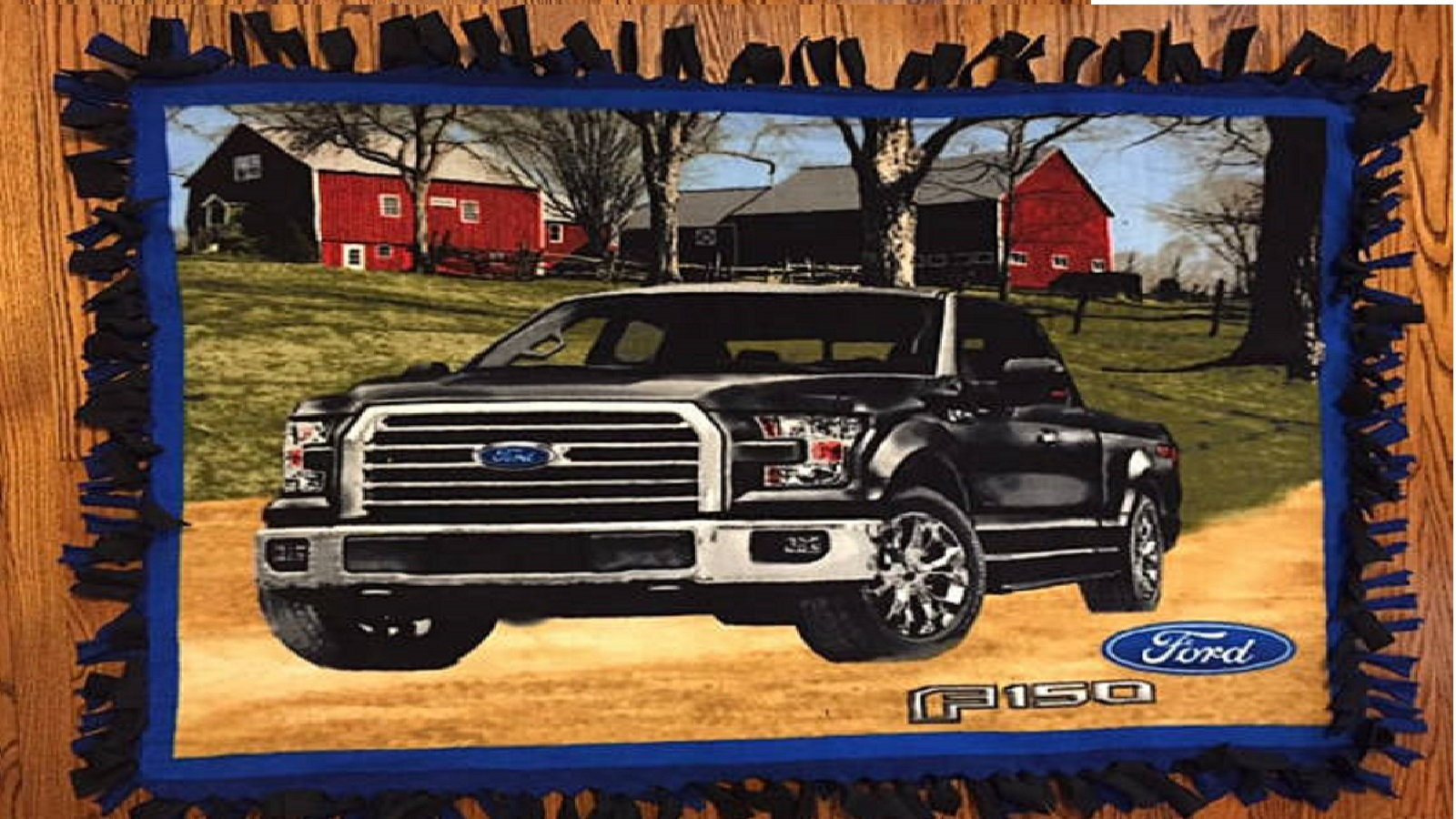 Promote warmth with a Ford truck fleece blanket.