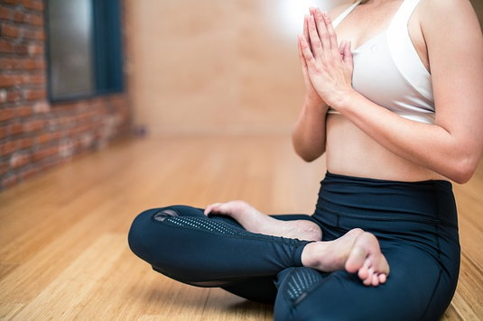 Yoga with breast implants