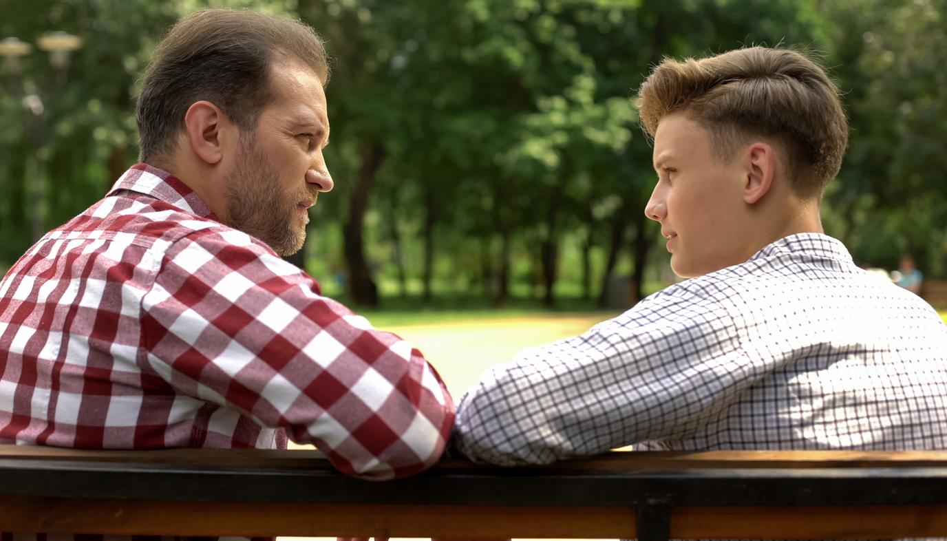 teen and dad talking