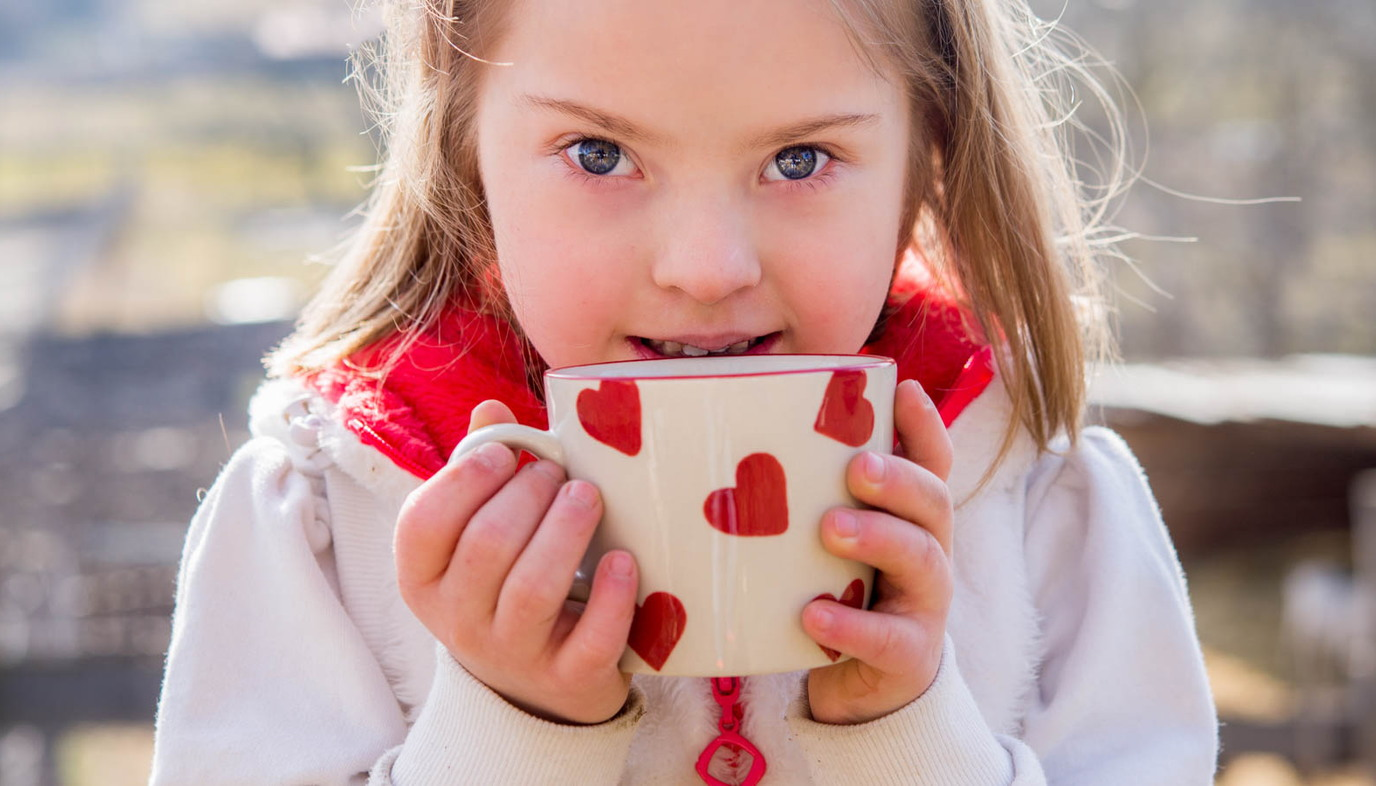 girl with Down Syndrome drinking tea