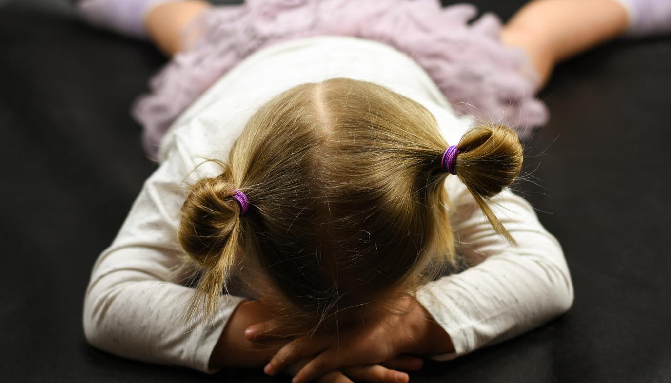 little girl having a tantrum on the floor
