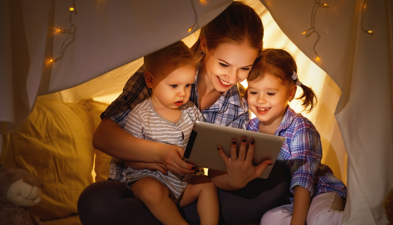 mom reading story to children
