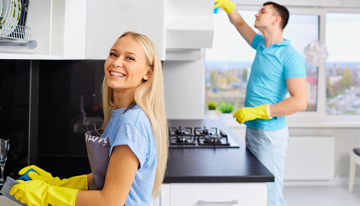 husband and wife cleaning house