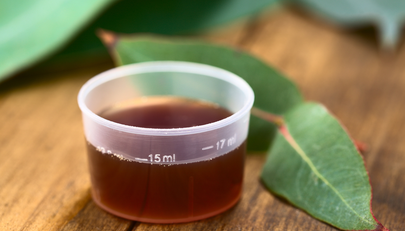 dosing cup with cough medicine