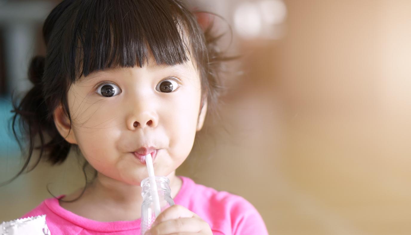 girl drinking soy milk