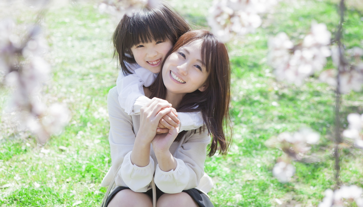 girl hugging mom