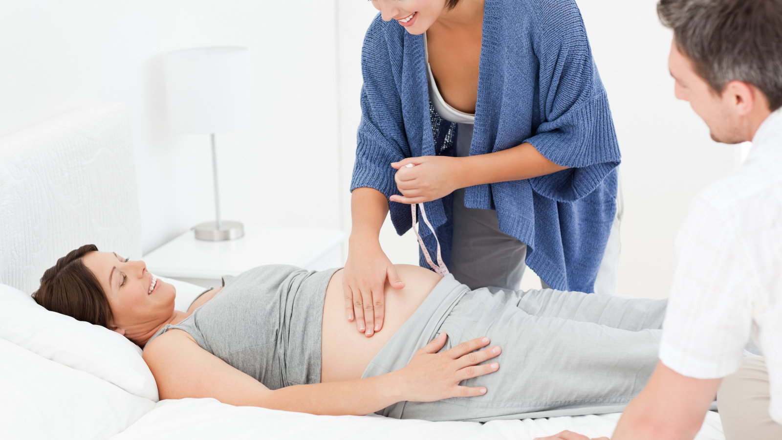 midwife checking pregnant mom at home