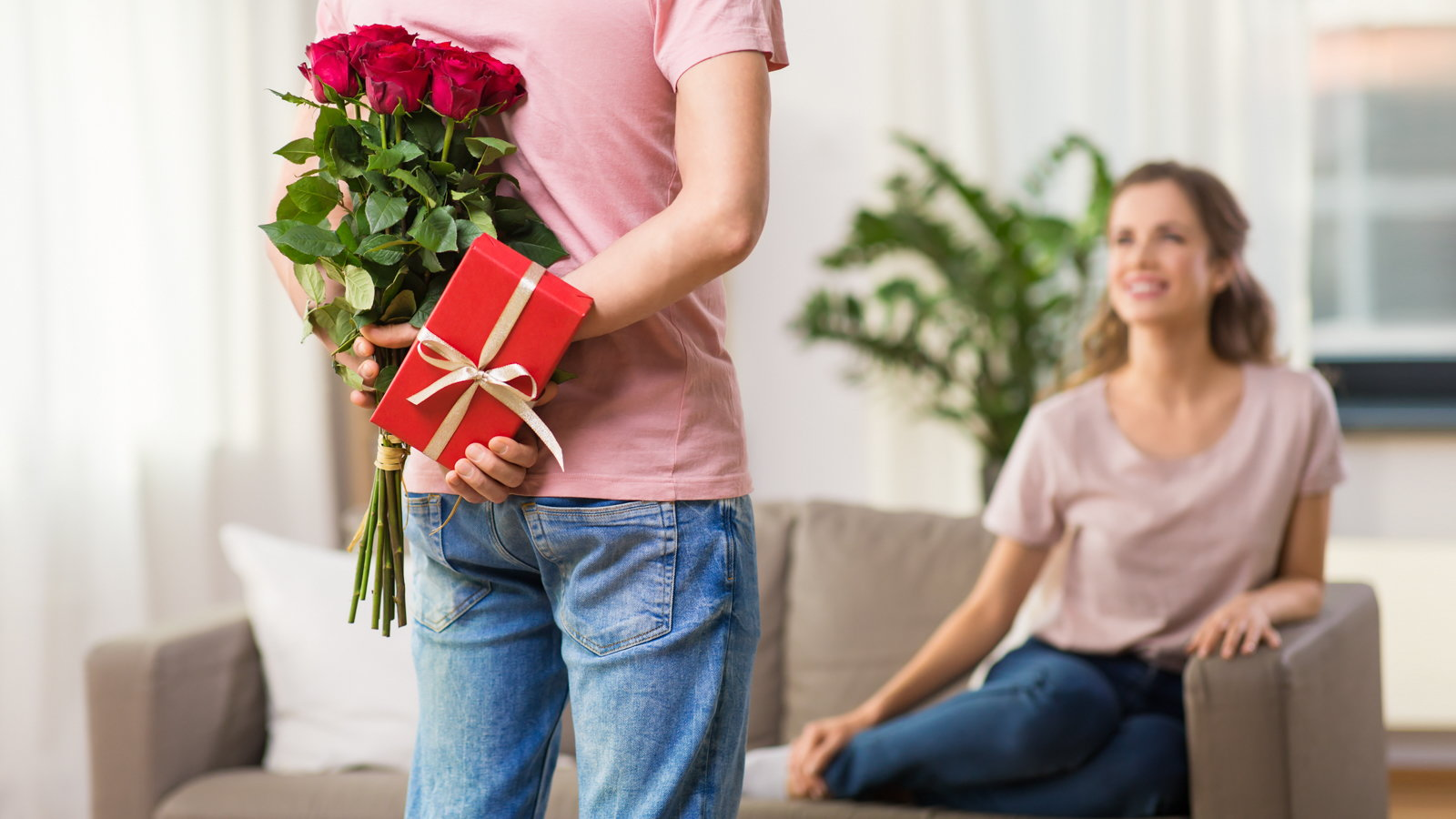 man giving Valentine's gift to wife