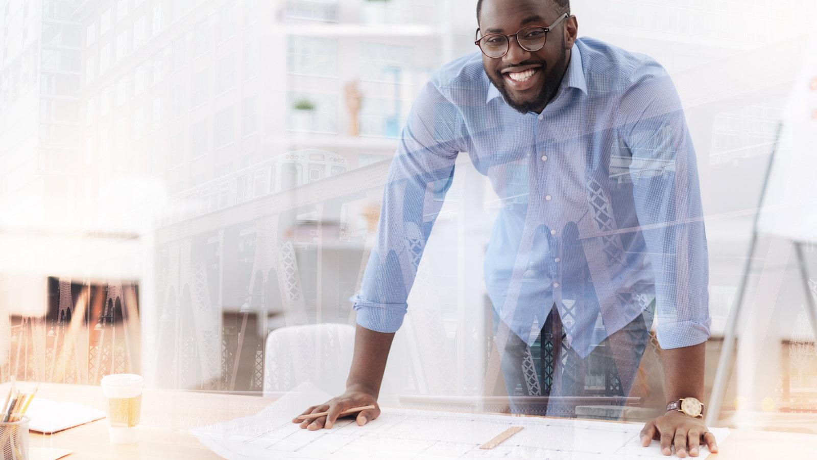 man making plan at table