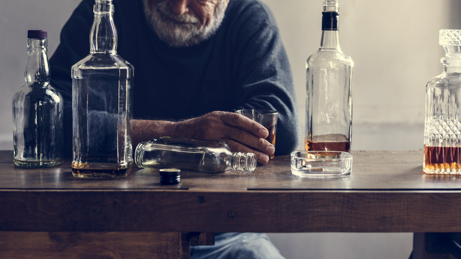 older man drinking alcohol