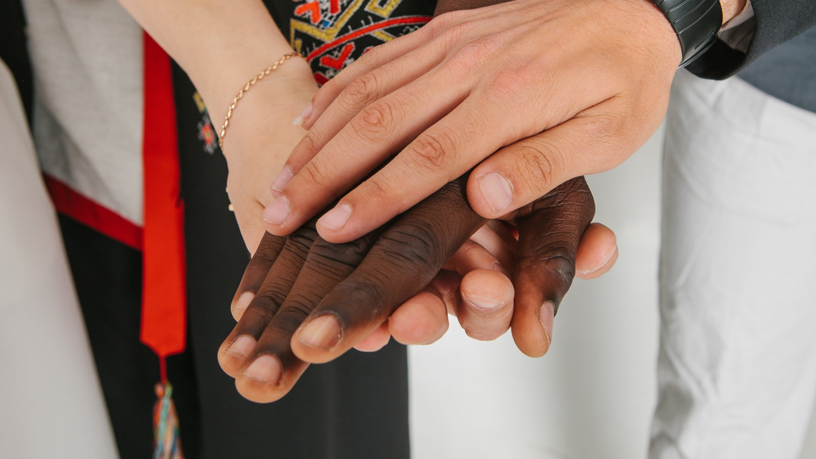 different nationalities holding hands