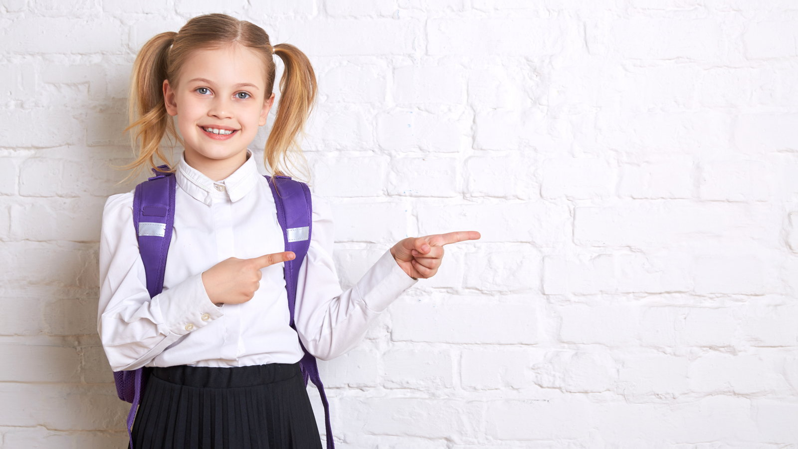 girl wearing school uniform with backpack