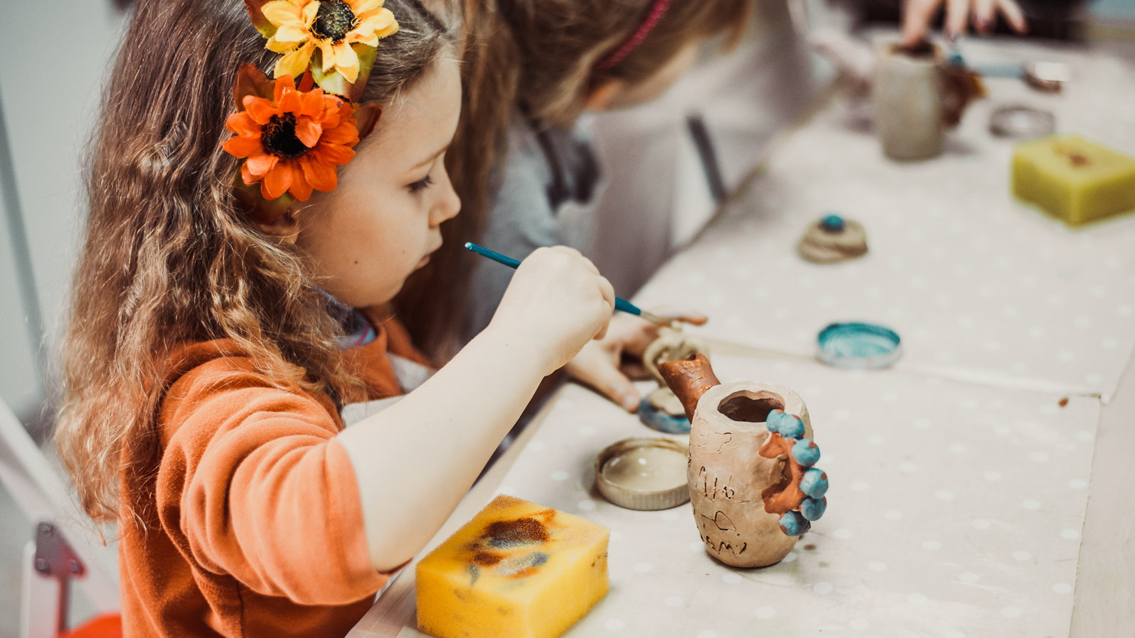 girl painting a craft