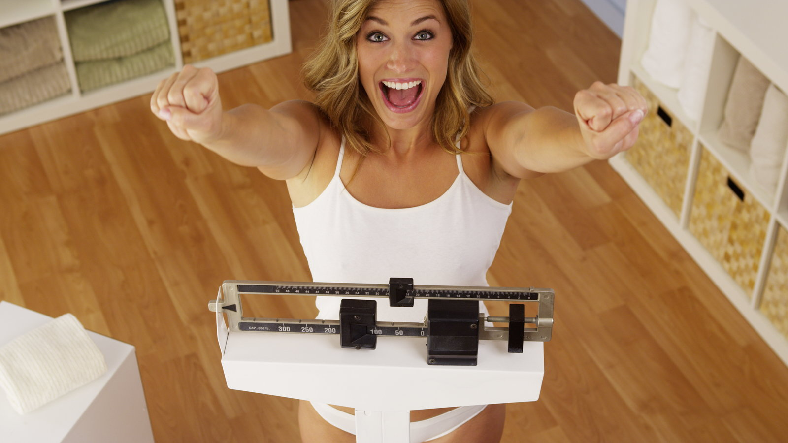 woman excited about weight loss