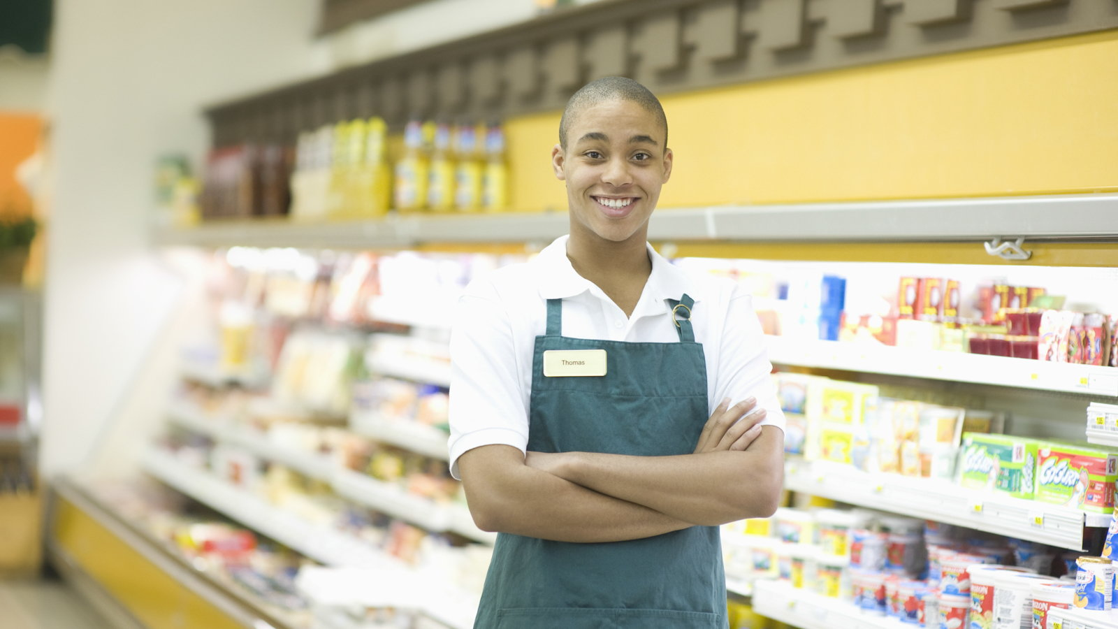 teen working at grocery store