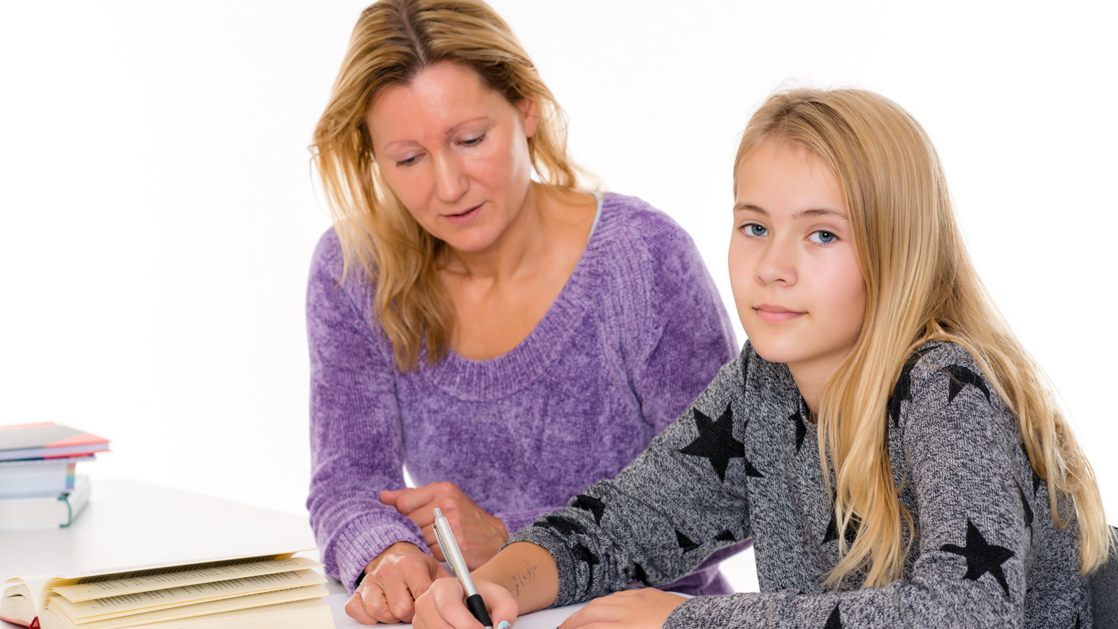 mom and teen daughter studying