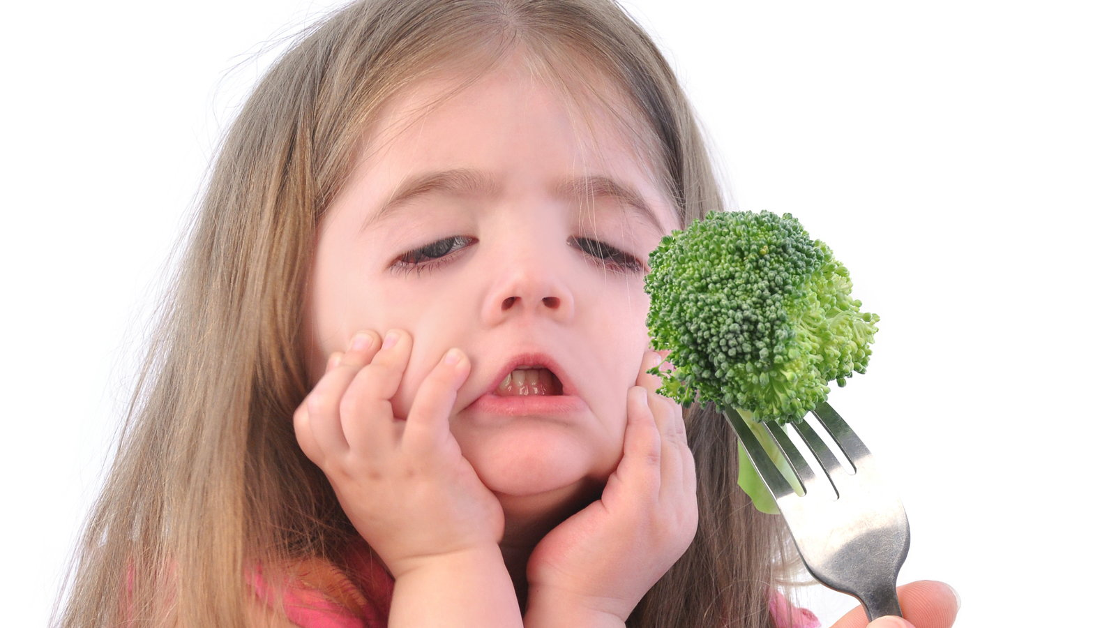 girl refusing to eat brocolli