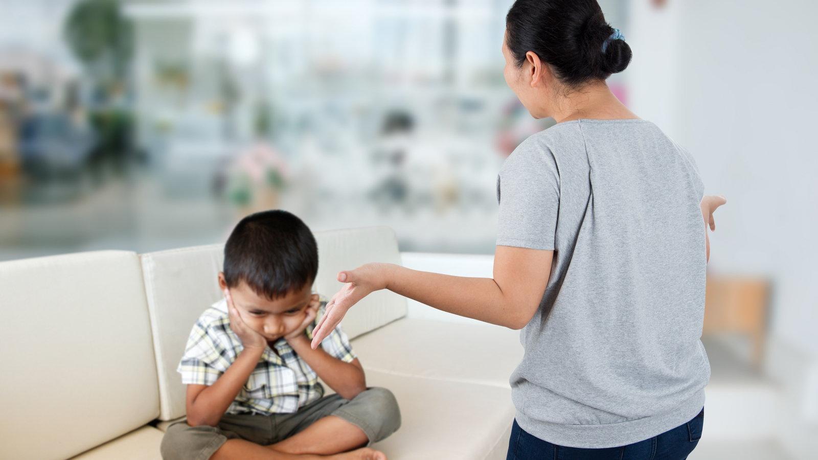 mom scolding son