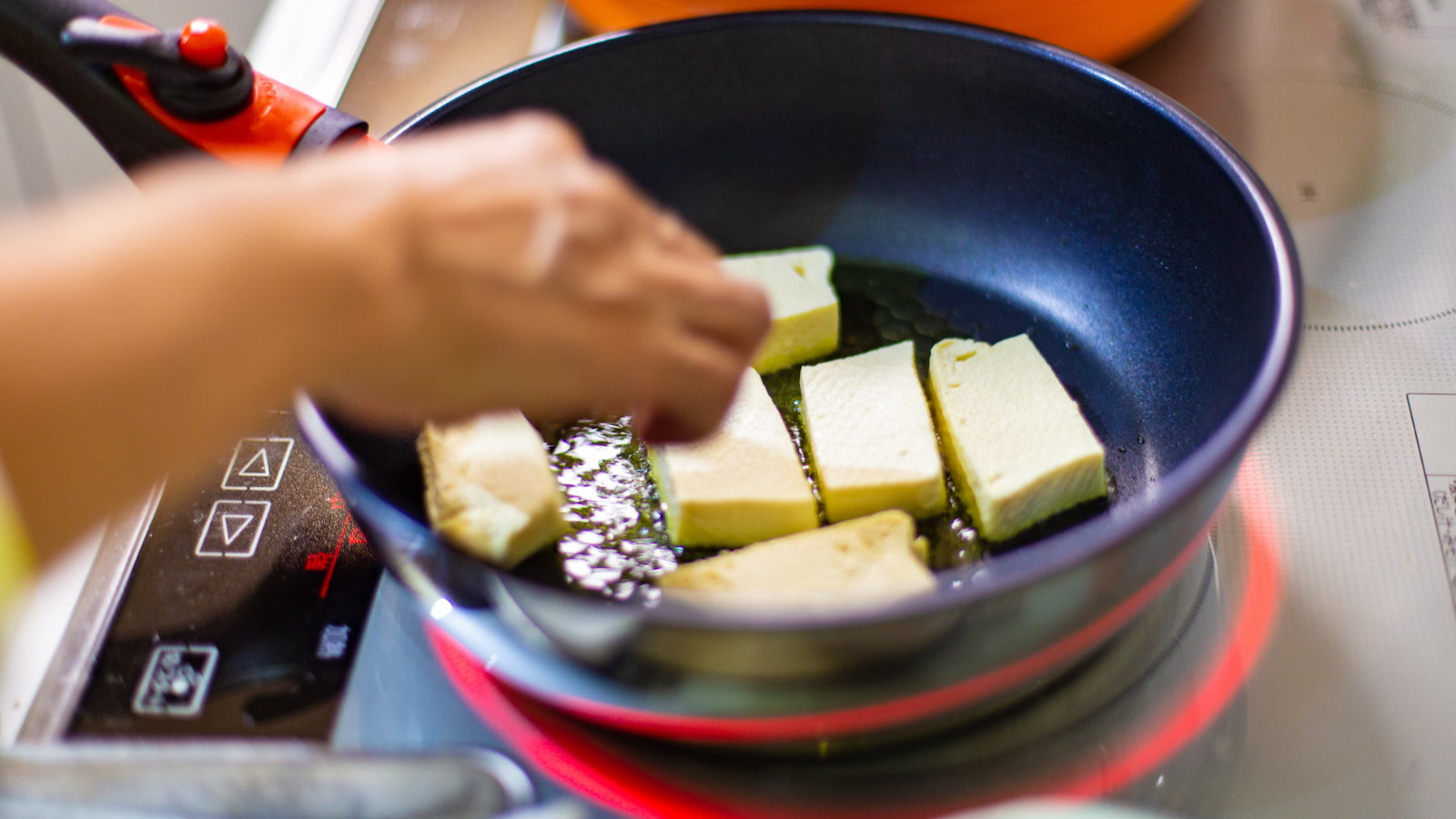 tofu being stir fried