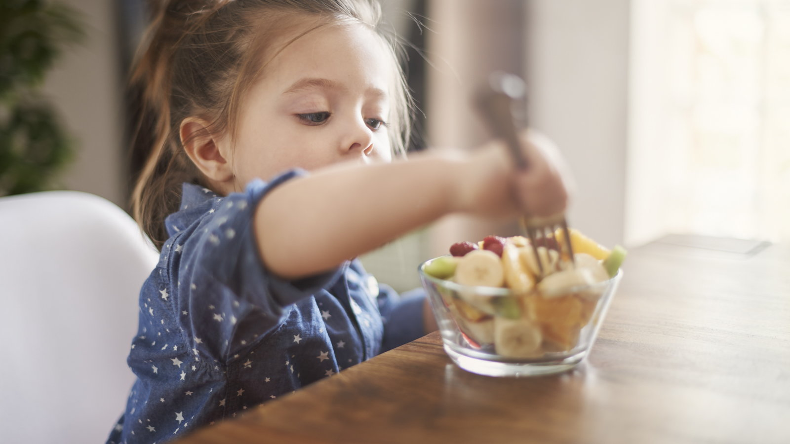 girl eating fruit