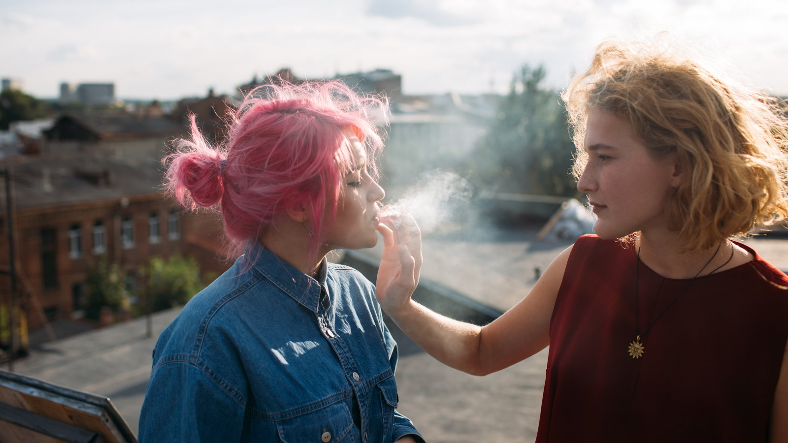 teen smoking a cigarette with a friend