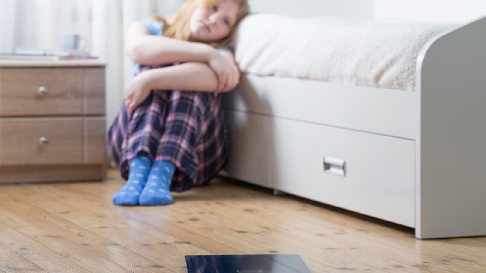 depressed teen in bedroom