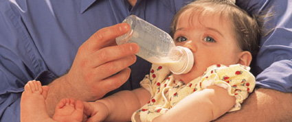 baby with bottled breast milk