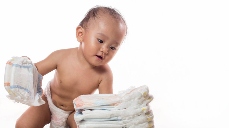 Baby crawling with diapers