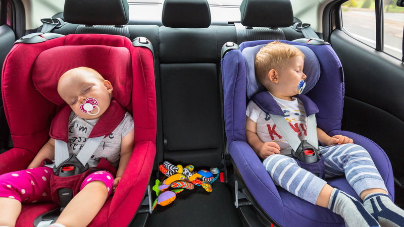 Twins in baby seats