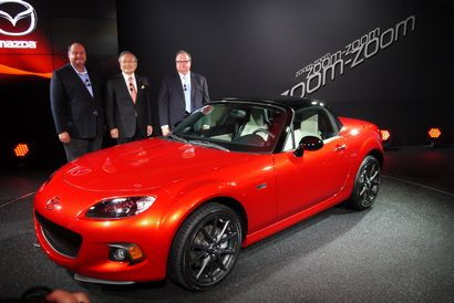 Takashi Yamanouchi behind the 2015 Mazda MX-5 Miata 25th Anniversary Edition