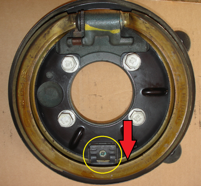 Remove retaining clip or drive the parking brake shoe off of the clip (assembly removed from vehicle for visual purposes)