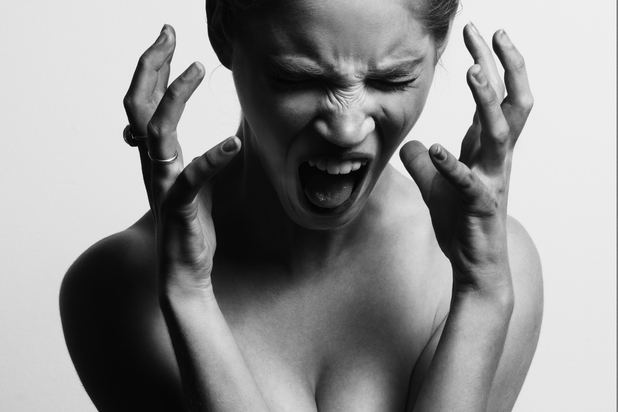 angry woman with hands near her face