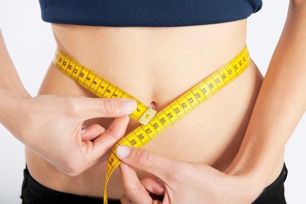 Person measuring their waist