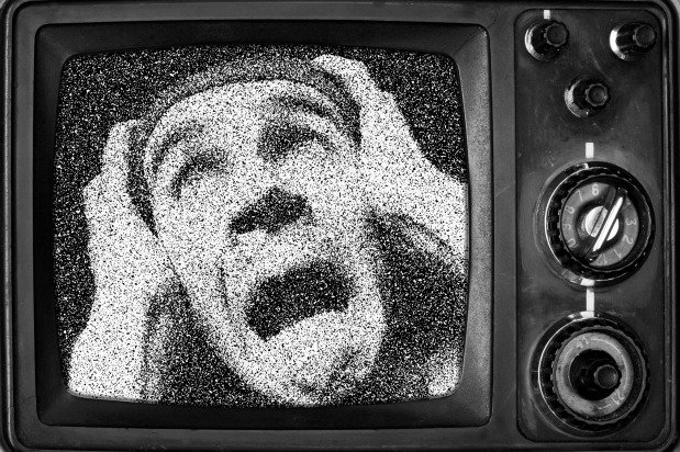 Man screaming on TV screen