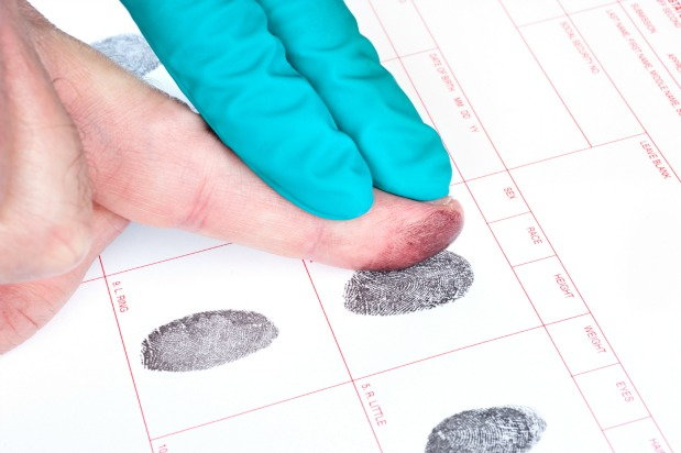 man getting his fingerprints taken