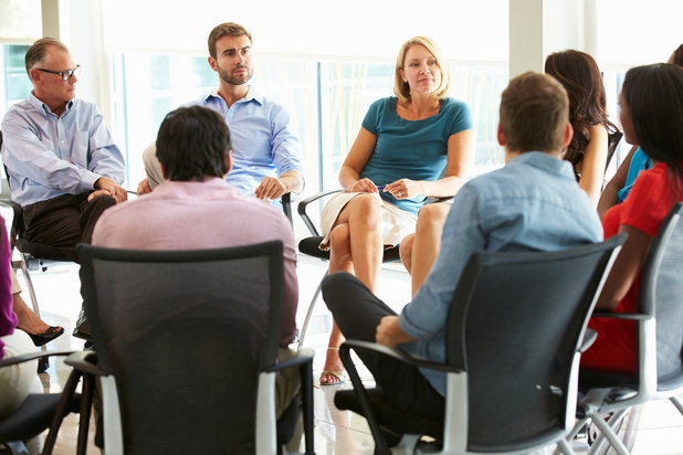An Alcoholics Anonymous group meets to discuss their experiences with addiction.