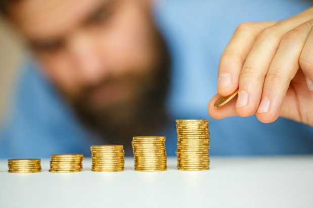 bearded man stacking coins