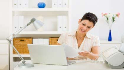 a woman working in her home office - Working In Home Office