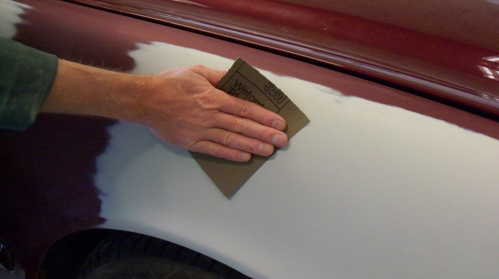 sanding exterior of car