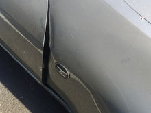 Bent fender. Replace or can an autoshop fix it?