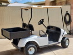 EZGO TXT Electric 36v golf cart with utility bed