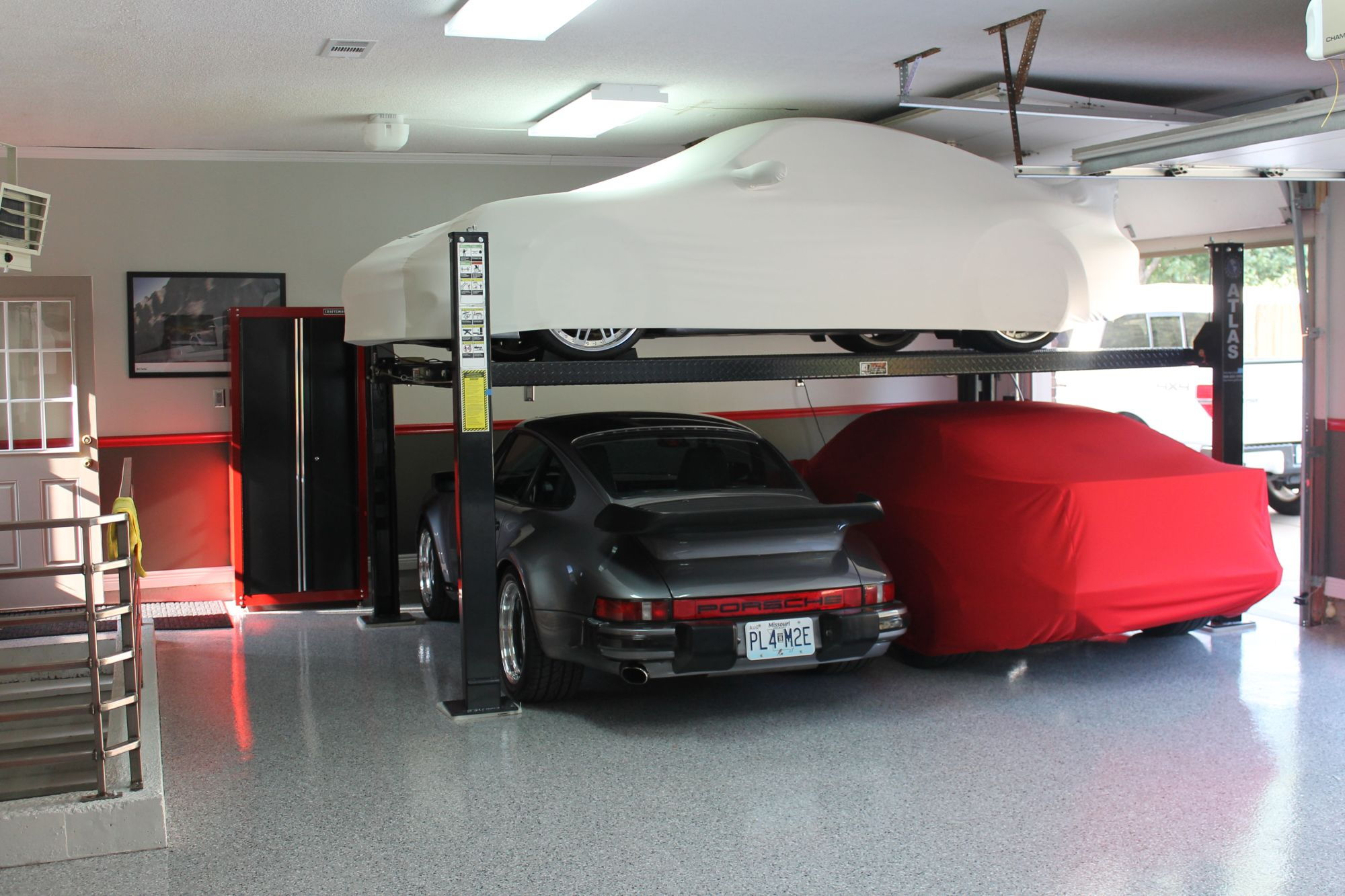 Guys with 4 post car lifts in their garages i have for Garage low cost auto
