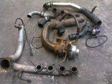 Old parts of turbo kit sc400 kept the headers and swaped everything else
