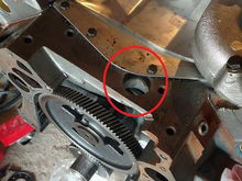 at the front of the valley pan above cam shaft drive gear.